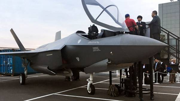 Arms firms show off wares as Japan eyes more F-35 stealth jets