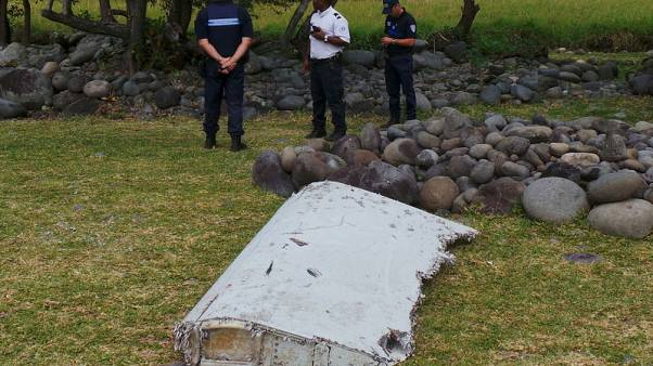 Relatives of missing from Malaysia plane say they have found pieces of debris