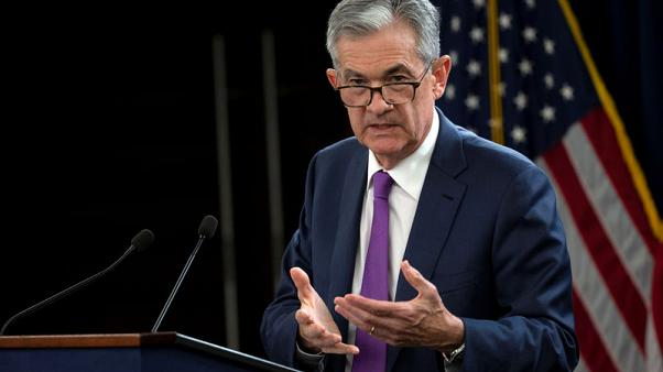 Fed's Powell, in dovish shift, says rates near neutral