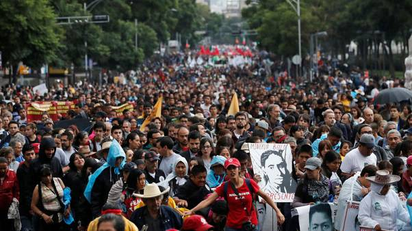 Mexico rights agency slams missing student probe, cites 19 burnt remains found