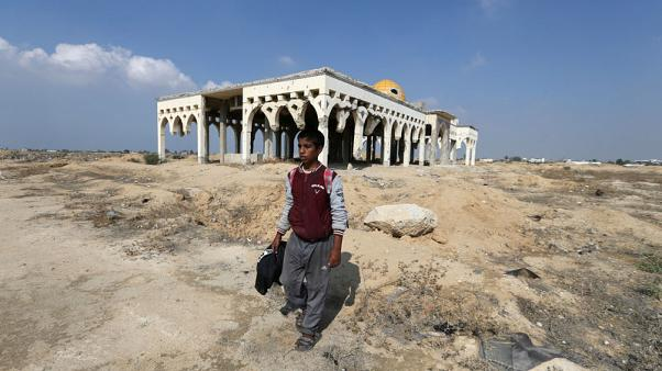 Catching songbirds at Gaza's ruined airport