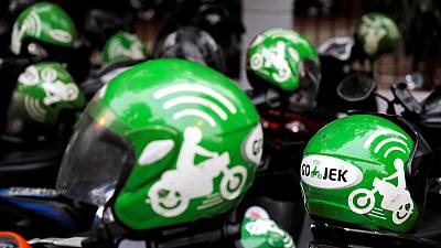 Grab, Go-Jek wage street fight for SE Asia 'super-app' supremacy