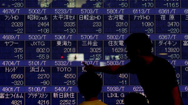 Asian shares wobble before Trump-Xi meeting