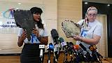 Kin of missing from Malaysian plane hand over suspected debris, urge search
