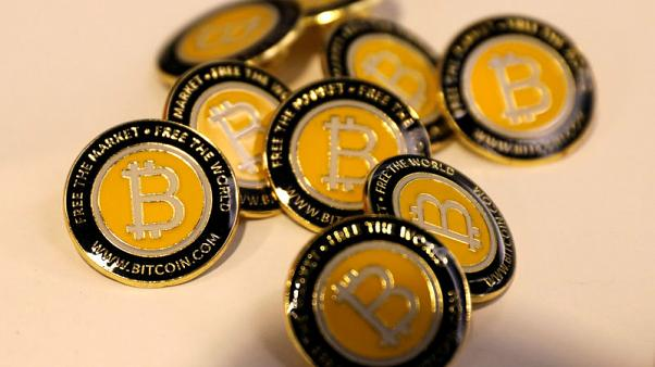Bitcoin falls over 7 percent, heads towards one-year low