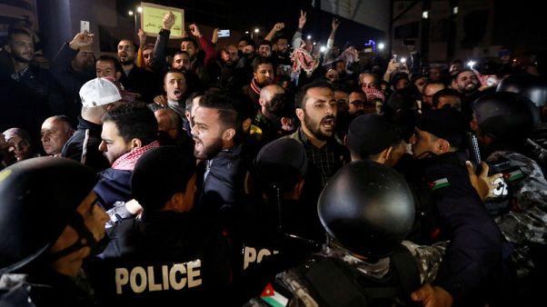 Hundreds of Jordanians protest against new tax bill