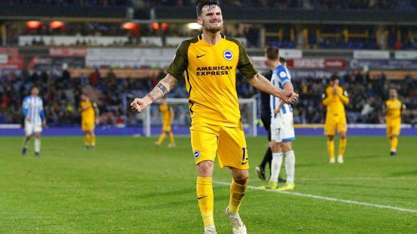 Brighton bounce back to beat 10-man Huddersfield 2-1