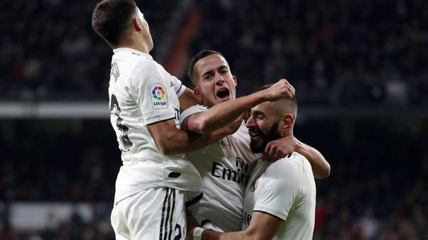 Real Madrid fumble their way to victory over Valencia