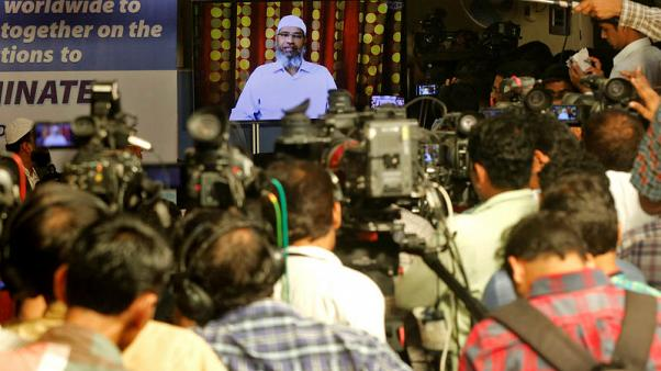 Wanted in India, fiery Islamic preacher says he has not broken any law