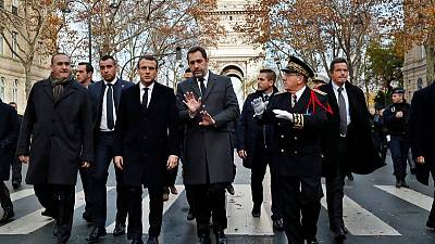 Macron visits riot-damaged Arc de Triomphe, state of emergency mulled