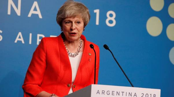 Hoping to win Brexit support, May says world leaders ready for trade