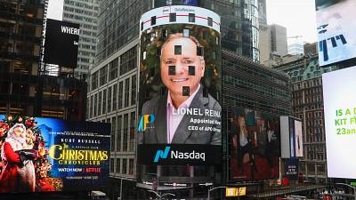 A picture of APO Group new CEO, Lionel Reina, displayed on the NASDAQ Tower in New York's Time Square