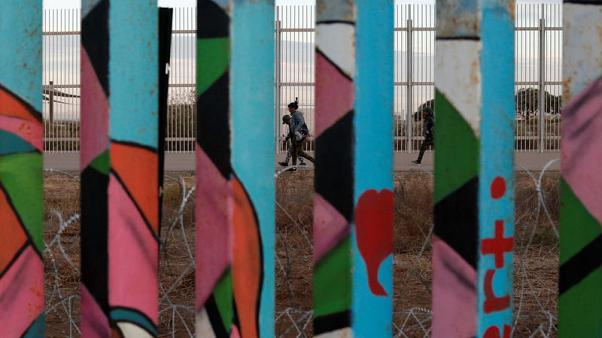 Tired of waiting for asylum, migrants from caravan breach U.S. border