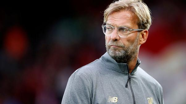 Klopp fined for running onto pitch in Merseyside derby