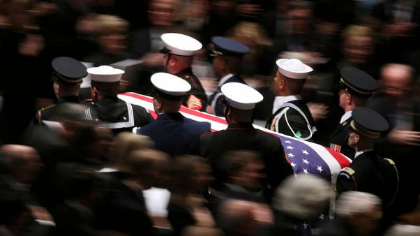 Master of bygone civility, Bush is hailed at funeral as U.S. 'soldier-statesman'