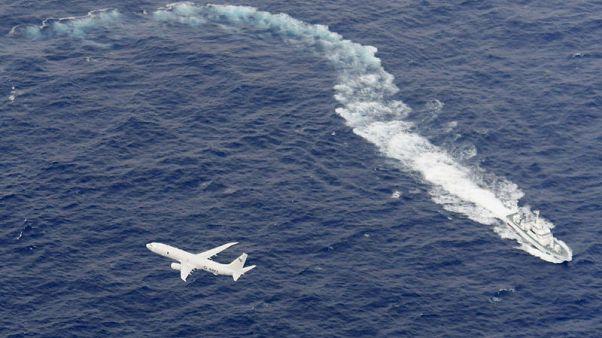 Crash kills U.S. Marine; teams search for five in sea near Japan