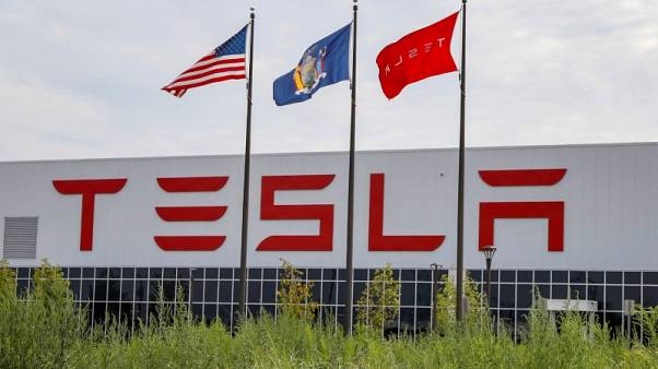 Tesla plans to use stock-cash mix to pay off March debt - Bbg
