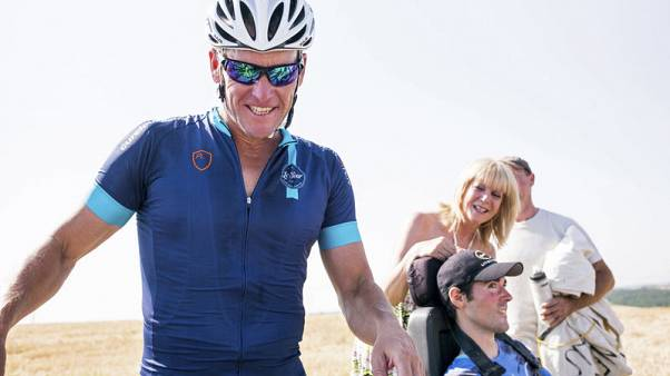 Armstrong says Uber investment saved his family - report