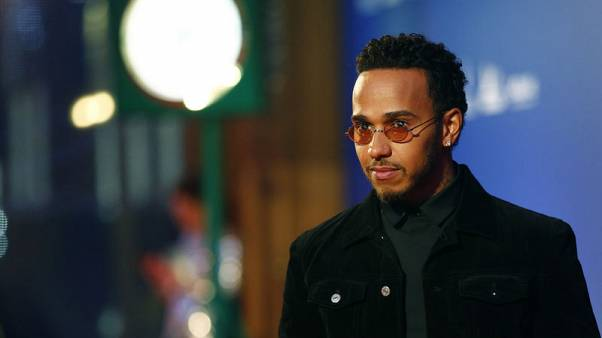 Hamilton collects F1 trophy and eager for more