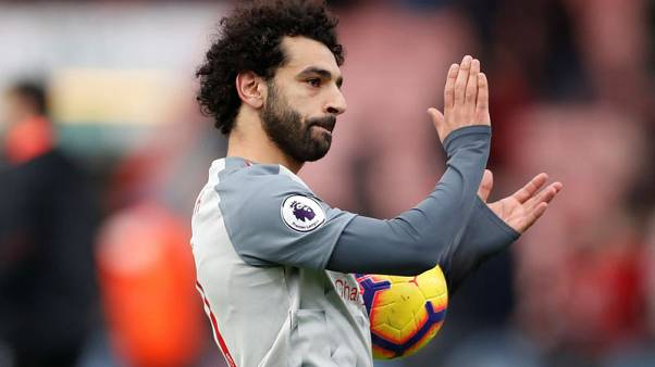 Superb Salah treble at Bournemouth sends Liverpool top