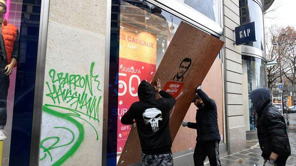 Paris cleans up as Macron prepares response to yellow vests