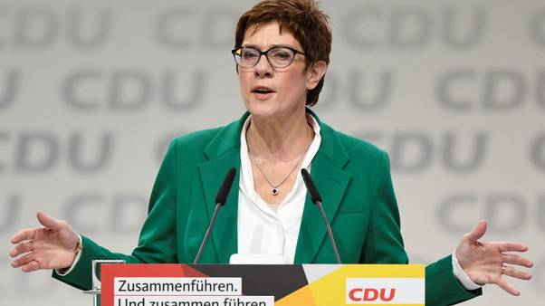 Germany's new CDU chief to review liberal Merkel migration policies