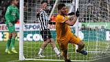 Soccer-Newcastle beaten in added time by Wolves after sending off