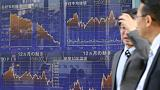 Asia stocks cautious, pound pummelled by politics