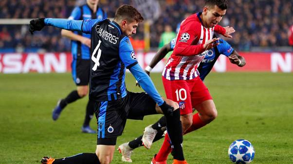 Atletico draw in Bruges to give Dortmund top spot in group