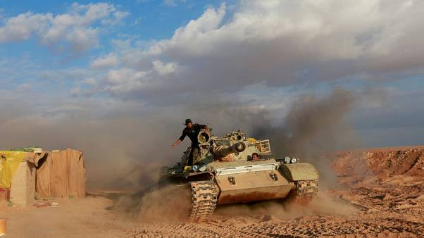 On Iraq's border with Syria, Iran-backed militia warily eye U.S. forces