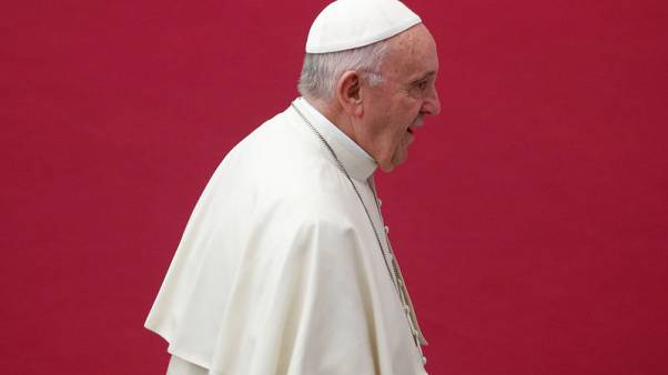 Pope removes two cardinals hit by scandal from group of close advisers
