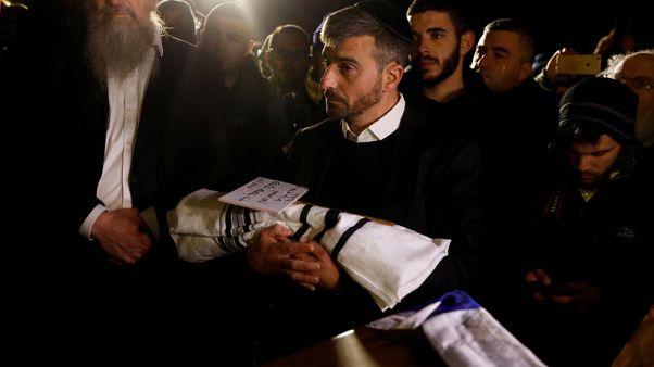 Israeli woman hurt in Palestinian attack loses baby, gunman killed