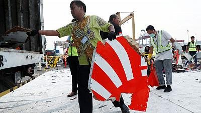Lion Air crash victims' families rally as hunt for wreckage steps up