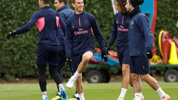 Arsenal's Koscielny finds his smile on return from injury