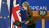 Brexit: May croit encore possible d'obtenir des garanties, l'UE veut calmer le jeu