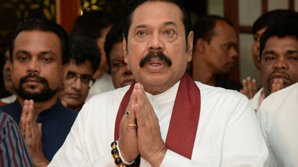 Sri Lanka's newly appointed PM Rajapaksa resigns - party lawmaker, son