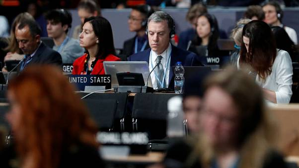 Nations agree global climate pact rules after overcoming impasse