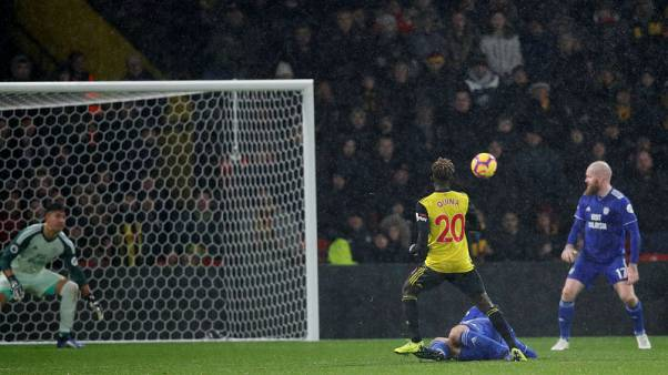 Watford hang on to nervy win over Cardiff