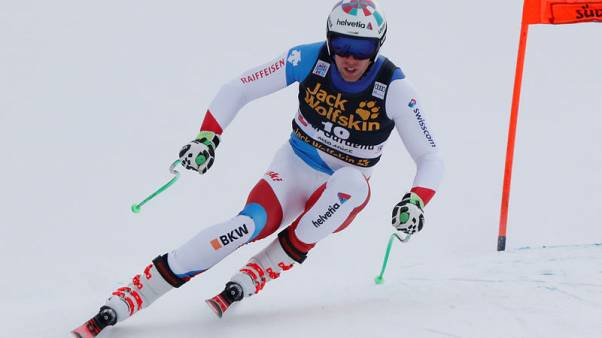 Alpine skiing - Swiss racer Gisin stable after dramatic crash