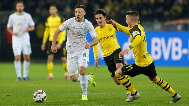 Dortmund beat Bremen 2-1 to guarantee 'autumn title'