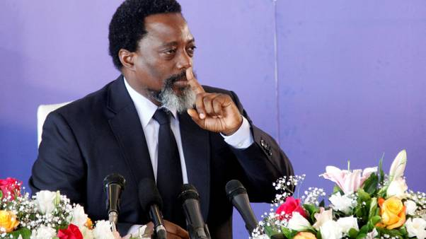 Bowing out as president, Congo's Kabila raises prospect of a return act