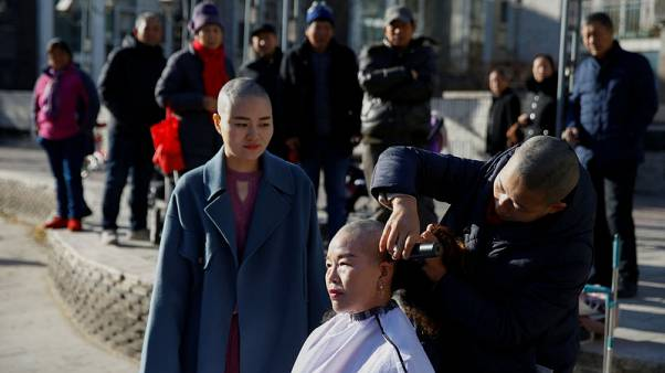 Four Chinese activists shave heads to protest 'persecution' of husbands