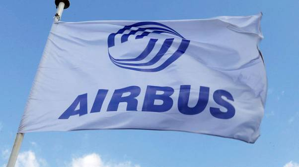 Airbus to boost some pay as Macron urges French firms to tackle crisis