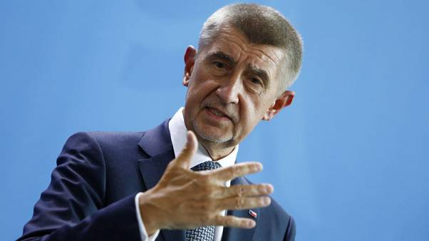 Czech PM, to avoid conflict of interest, steps down from government body