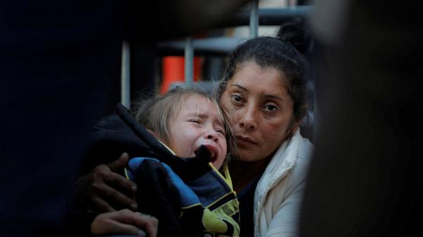 Migrant family who fled tear gas at U.S. border seeks asylum