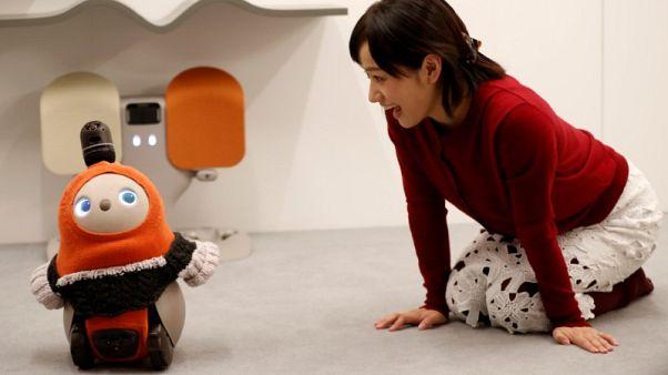 SoftBank alumni unveils 'affectionate' companion robot in Japan