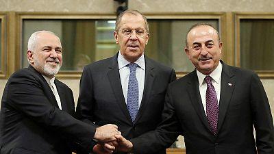 Russia, Iran, Turkey meet, seeking deal on new Syria constitution body