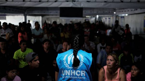 U.N. formally approves global migration pact opposed by U.S., others
