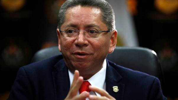 El Salvador's top cop pursues politicians; now some want him gone