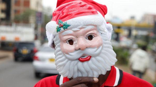 Santa hats, beards and tinsel: Christmas trade on African streets